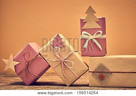 Gift boxes handcraft stack. New Year 2016 on wood