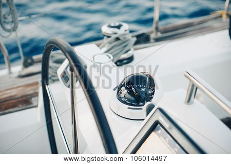 Sailing yacht control cockpit, wheel and implement.