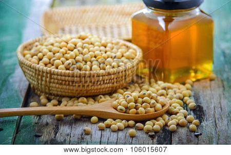 Closeup Is Some Soybeans With Wooden Spoon
