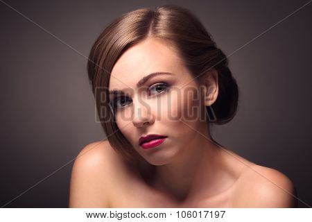 Sexy beautiful woman isolated on grey