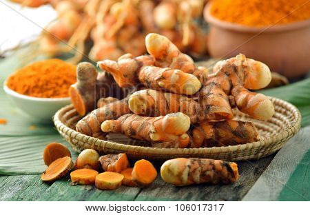 Fresh Turmeric Roots In The Basket On Wooden Table