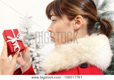 Woman With Christmas Gift, Amazed