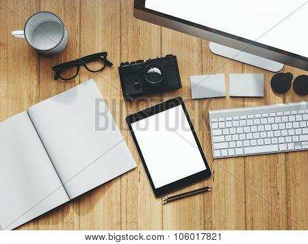 Photo of modern workspace with desktop screen, tablet, camera, keyboard, book.   3D rendering