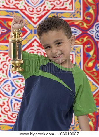 Adorable Young Boy With Small Ramadan Lantern