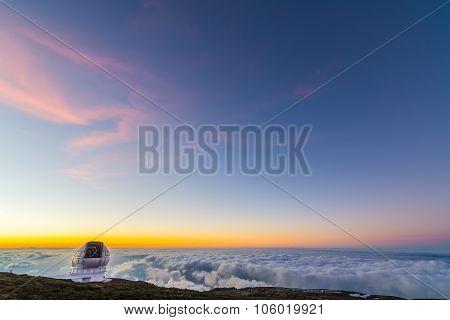 Big telescope at sunset