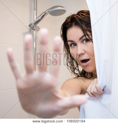 Pretty Woman Hiding Behind Shower Curtain