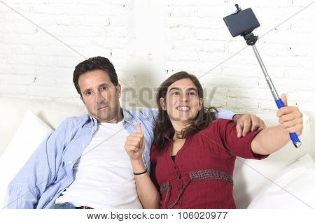 Couple With Woman Taking Selfie Photo With Mobile Phone And Stick Man Tired And Sick Of Pictures