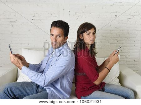 Young Antisocial Mobie Phonel Addict Couple Ignoring Each Other Using Internet Compulsively