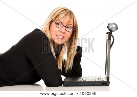 A Businesswoman Using Notebook And Webcam