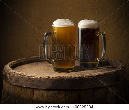 Still life: old wooden pint of beer, glass of beer on the table in the cellar.