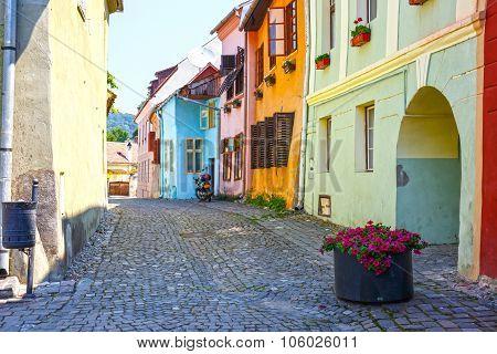 SIGHISOARA, ROMANIA - JULY 08: Medieval street view in Sighisoara, Romania