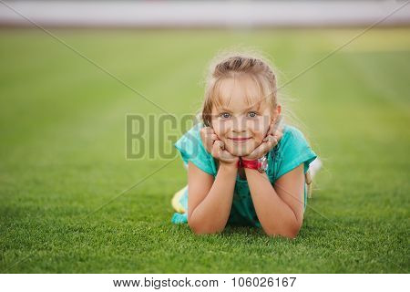 little funny girl on football stadium