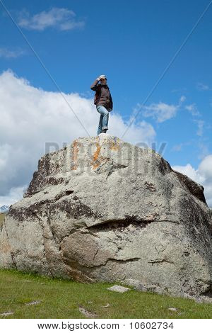 A Young Woman Climbs On The Cliff Top