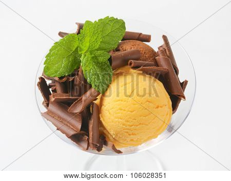 glass of vanilla and chocolate ice cream sundae with chocolate shavings