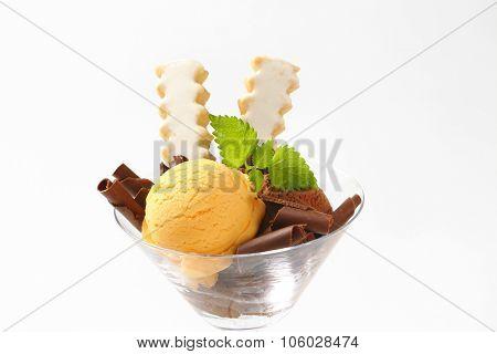 close up of vanilla and chocolate ice cream sundae with lemon cookies