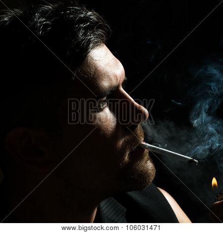 Unshaved Man Lights Up Cigarette