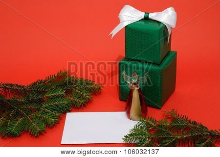 Christmas Gift Boxes And Letter On The Red Background