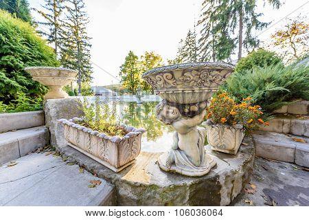 Child water basin statue