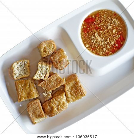 Fried Tofu Or Bean Curd And Sauce Isolated On White