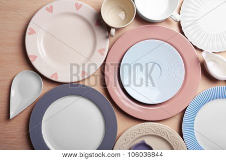 Composition of tableware on rosy background