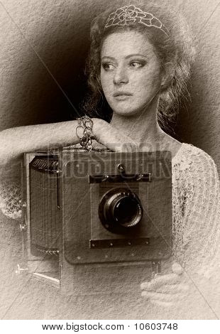 Young Woman Near The Old Camera
