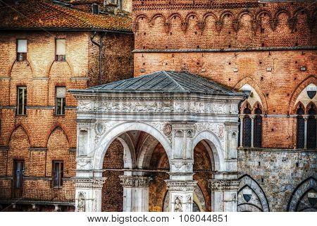 Marble Loggia Of Torre Del Mangia In Siena
