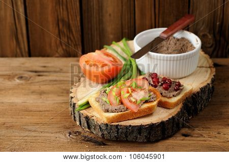 Homemade Liver Pate On Toasts With Tomatoes, Scallion And Cranberries On Wooden Board Copyspace