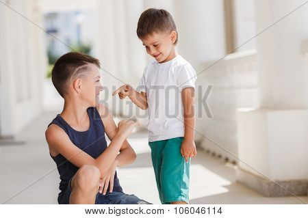 Two siblings spend their time on the street