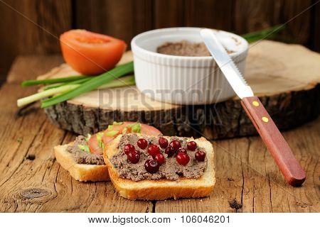 Homemade Liver Pate On Toasts With Tomatoes, Scallion And Cranberries On Wooden Board