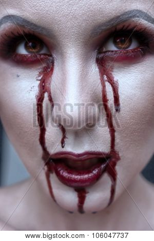 Beautiful Vampire Woman, Close-up Red Lips And Eyes In Blood. Halloween Or Horror Theme.