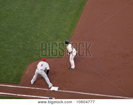 Buster Posey Takes Lead From First With Ryan Howard Standing On The Base