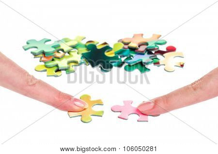 Solution puzzle two women fingers isolated on white