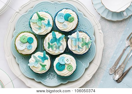 Cupcakes decorated with sugarpaste butterflies and buttons
