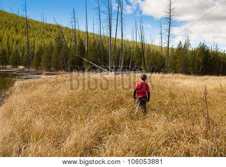 Boy Playing By Lake.