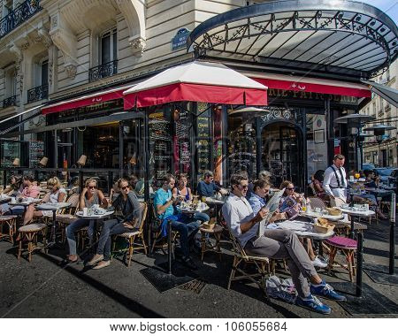 Outdoor cafe scene on a sunny summer day