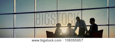 Group of Business People Meeting in Back Lit Concept