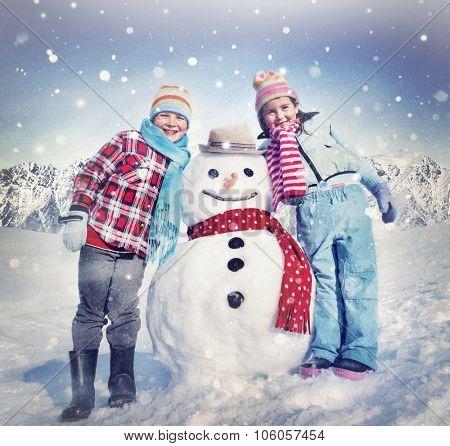 Little Girl and Boy Outdoors Winter Snowman Concept