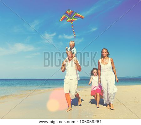 Family Beach Holiday Flying Kite Sea Togetherness Concept