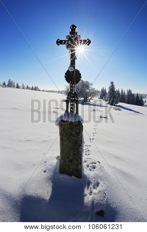 Winter Landscape And Wooden Cross With Frosted Snow In Fogv