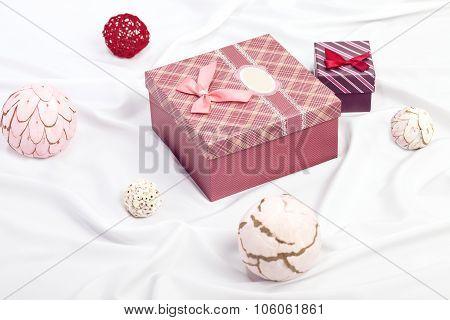 Two gift boxes on white satin background