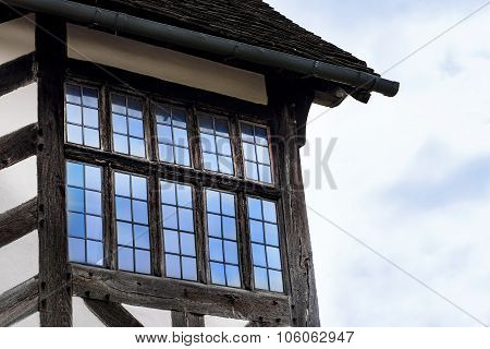 Tudor house exterior detail built in 1590 detail of window and roof Blakesley hall closeup