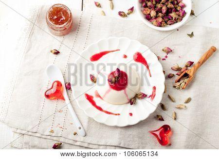 Panna cotta,with berry sauce. Italian dessert.