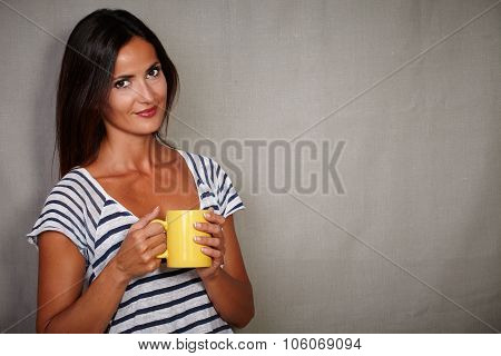 Satisfied Brunette Woman Holding Coffee Cup
