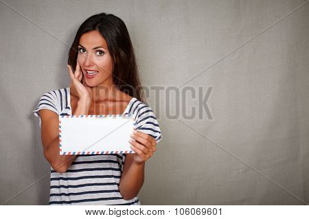 Young Lady Holding Letter While Looking Impressed