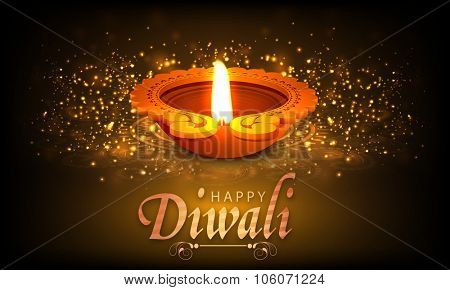 Creative illuminated oil lit lamp on shiny floral design decorated background for Indian Festival of Lights, Happy Diwali celebration.
