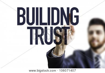Business man pointing the text: Building Trust