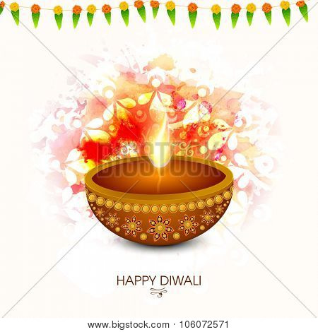Traditional illuminated oil lit lamp on creative abstract background for Indian Festival of Lights, Happy Diwali celebration.
