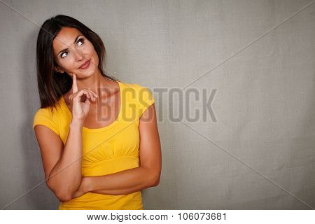 Pensive Brunette Lady Thinking While Looking Away