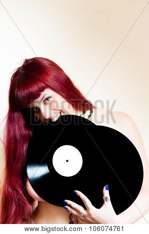 Young Woman Smiling With Vinyl Records