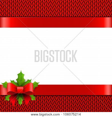 Christmas background with bow and holly berries on red knitted p